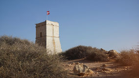 A typical Maltese knight tower. On the cliff on the island of Malta, Ghajn Tuffieha Tower Royalty Free Stock Photo