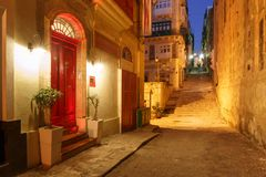 Night street in old town of Valletta, Malta. Typical Maltese medieval street at night in the center of the Old Town of Valletta, Malta Royalty Free Stock Photos