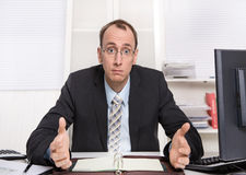Typical managing director or controller - arrogant and disagreeable sitting at desk with computer