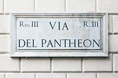 Typical marble street name sign in Rome. Typical marble street name sign on building wall in Rome, Italy Royalty Free Stock Photos