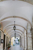 Typical medieval arched corridor. View of a typical Portuguese medieval arched corridor located in Setubal, Portugal Royalty Free Stock Image