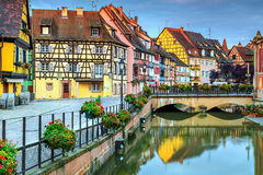 Typical medieval half-timbered facades reflecting in water,Colmar,France. Amazing colorful traditional french houses on the side of river Lauch in Petite Venise Stock Photos
