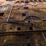 Typical medieval house facade in Siena Stock Photo