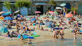 Holiday on the Beach in Spain in Summer. Typical Mediterranean beach in Summer day stock footage