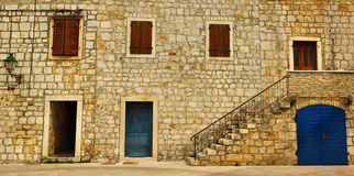 Typical Mediterranean Stone Building. Typical Mediterranenan Stone House with Window Shutter Boxes royalty free stock photos