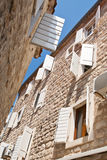 Typical mediterranean street. With wite louvers on windows Royalty Free Stock Photos