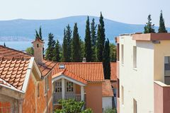Typical Mediterranean urban landscape: houses with red tiled roof , green cypresses. Montenegro, Tivat town. Typical Mediterranean urban landscape: houses with stock image
