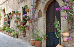 Typical Mediterranean Village with Flower Pots in Facades in Val Royalty Free Stock Image