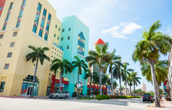 Typical Miami retro buildings acroos street on shady side. Stock Photos