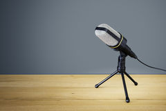 Typical microphone on a wooden desk Royalty Free Stock Photography