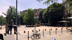 Milan, Italy, Typical Milanese yellow tram passes in Piazza Arco della Pace. Typical Milanese yellow tram passes in Piazza Arch of Triumph, Milan. Sunny day stock video footage
