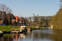 Typical motor boats on a canal in East Frisia Stock Image