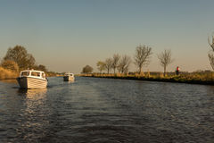 Typical motor boats on a canal in East Frisia Stock Photos