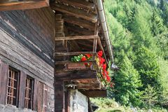 Typical mountain house with flowered balcony, European Alps stock photography