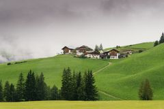 Typical mountain houses on a hill in Alto Adige / South Tyrol, Italy.  stock photography