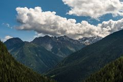 Typical mountain landscape on the Italian dolomites. Typical mountain cloudscape on the Italian dolomites royalty free stock image