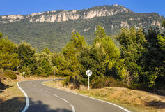Typical mountain road in Spain with crossed 60 km/h speed limit. Royalty Free Stock Photos