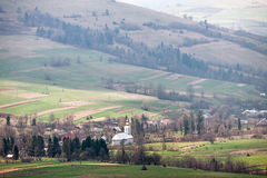 Typical mountain village with a church in Carpathians Royalty Free Stock Photography