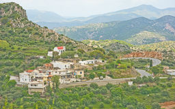 Typical mountain village in Crete. An image of a typical mountain village in Crete  with church, narrow winding road and surrounded by olive trees Stock Photos