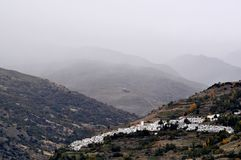 Typical mountain village in fog Royalty Free Stock Photography