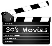 30`s Movies Clapperboard. A typical movie clapperboard with the legend 30`s Movies isolated on white Royalty Free Stock Photography