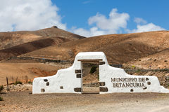 Typical municipality sign (white arch gate) near Betancuria Royalty Free Stock Photography