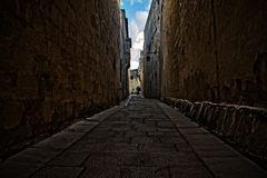 A narrow alleyway in Mdina, Malta royalty free stock images