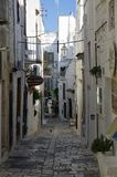 Typical narrow little street with a lots of stairs in Ostuni, La Citta Bianca. Ostuni. Puglia, Italy royalty free stock photography