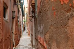 The typical narrow path in Venice, Italy Stock Photos
