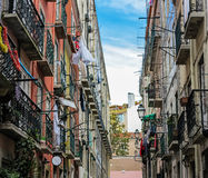 Typical narrow road in the old town in Lisbon, Portugal Royalty Free Stock Photo