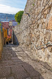 The typical narrow and steep medieval street of the older parts of the city Royalty Free Stock Images