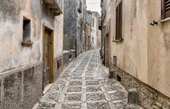 Typical narrow stone street in the medieval historical center of Erice, province of Trapani in Sicily. Typical narrow stone street in the medieval historical stock photos