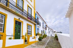 Typical narrow street in the ancient town of Mertola, Alentejo R Stock Photo
