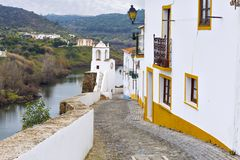 Typical narrow street in the ancient town of Mertola, Alentejo R Stock Photography