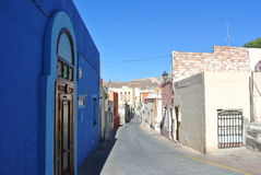Typical narrow street in the Andalusian seaside resort Almeria. With whitewashed facades, on a sunny summer morning Stock Photo