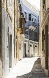 Narrow street on Malta. Typical narrow street on the island of Malta. Buildings with traditional colorful maltese balconies in historical part of Valletta Royalty Free Stock Photos