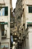 Typical narrow street of Italy. Typical narrowl European street on a mountain slope in the Mediterranean coast with stores, houses and clotheslines, Amalfi stock photo