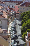 A typical narrow street in Lisbon in Portugal Stock Photography
