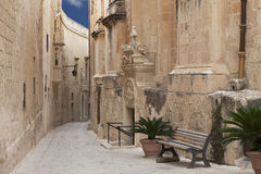 Typical narrow street in the medieval town Mdina, Malta Stock Photography