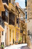 Typical narrow street in Valletta Stock Images