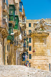 Typical narrow street in Valletta Stock Photos