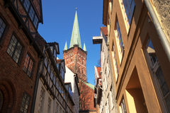 Typical narrow urban street and Church in the historic old town Stock Image