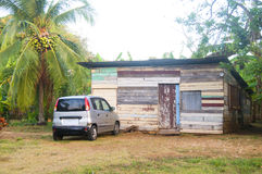 Typical native Nicaraguan wood clapboard house with taxi  jungle Stock Photos