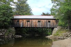 Typical new england covered bridge. During fall in forest royalty free stock images