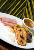 Typical nicaragua breakfast. Of ham and eggs with gallo pinto rice beans fried plantains with salsa sauce as photographed in corn island nicaragua central royalty free stock photo