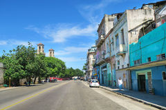 Typical non-central street of Havana. Cuba, Havana - 07 April, 2016: typical non-central street of Havana in a peaceful neighbourhood with blue sky in the Royalty Free Stock Image
