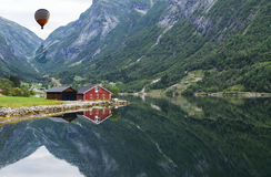 Red wooden house at norway fjord Royalty Free Stock Photography