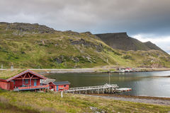 Typical Norwegian fishing village with traditional red rorbu hut Royalty Free Stock Photos
