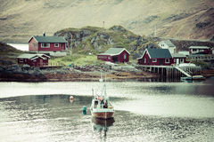 Typical Norwegian fishing village with traditional red rorbu hut Royalty Free Stock Image