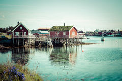 Typical Norwegian fishing village with traditional red rorbu hut Royalty Free Stock Photography